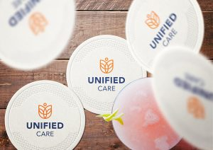 Unified Care logo on a coaster